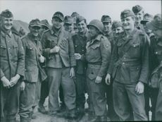 German prisoners smile after surrendering in Holland.