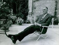 Pierre Marcilhacy relaxing on a chair.