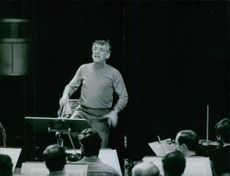 Portrait of an American composer, conductor, author, music lecturer, and pianist Leonard Bernstein during rehearsal. 1970
