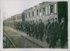 Soldiers walking together in the railway track during Tyskland war.