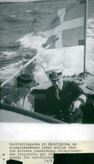 Louise Mountbatten discusses the rowing races at Hårsfjärden with the head of the coastal fleet, Amiral Ekstrand
