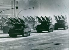 Mobile rocket launchers, equipped with ground-to-air missiles, parading through the streets of East Berlin.