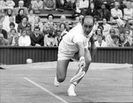 Bob Hewitt in action during the match mom C. Richey in Wimbledon in 1969