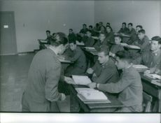 Don Juan Carlos de Bourbon, King of Spain, in classroom with other soldiers.
