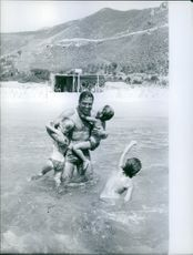 Raf Vallone having fun at the beach with his children.