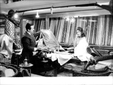 Lamia Solh, wife of Prince Moulay Abdellah of Morocco, choosing a fabric.