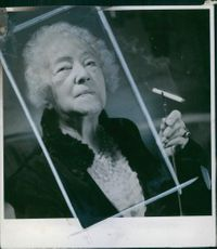 Close up of Swedish journalist and writer Anna Branting, while she hold a cigarette