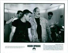 """Tom Cruise and director Brian De Palma play back a shot in the adventure thriller """"Mission Impossible""""."""