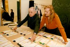 Pierre Bergé, co-founder of the company Yves Saint Laurent, oversees the order of the men's chains.