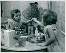 A kid touching the mirror. March 11, 1957