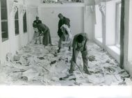 Men cleaning up the mess in Yemen.