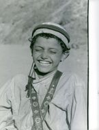 Child smiling in Yemen.