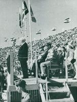 Israeli Prime Minister David Ben-Gurion talks in Jerusalem's stadium on the 10th anniversary of Israel's founding