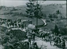 People walking with horse carts.