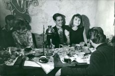 Sylvia Casablancas sitting with man at table.