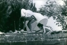 A photo of Princess Alexia in her playing activity with her brother.