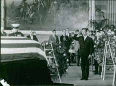 Nguyen Cao Ky saluting and paying respects to martyr.