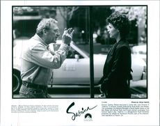 """Director Sydney Pollack discusses a scene with Julia Ormond in """"Sabrina,"""""""