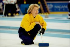 The skipper, Elisabet Gustafsson, keeps a close eye on the stone while heading towards one of the matches in the Olympic Games.