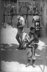 Three soldiers are in the corner of the street manning the area. 1962