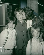 Mark Shaw 9, who was buried for eight hours beneath the rubble of a Spanish hotel with his brothers, Bradley (left) and Darren (4) receiving a welcome kiss from their grandmother, when the boys returned with their parents at Gatwick Airport