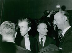 Gaston Naessens seen with the police magistrate. 1964.