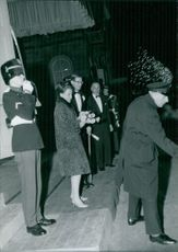 Princess Margriet of the Netherlands and her husband Pieter leaving a party.