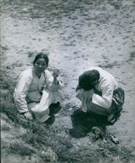 These two women lost all their possessions in the confusion of crossing the border from North into South Korea. 1950.