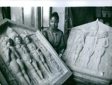 Marpessa Dawn looking at the ancient sculptures in Cannes. 1959.