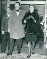 Jack Hawkins, and his wife Doreen on their way out of the hospital