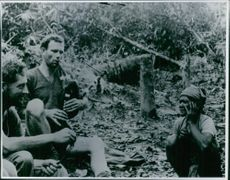 Men talking in the jungle.