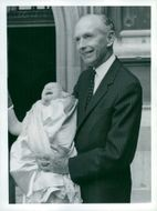 Sir Alec Douglas-Home at the baptism of his grandson Rory James