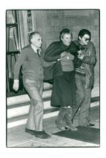 Judith Dozier escorted by Italian police after her husband was kidnapped