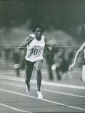 Sportswoman running during race on race track during The 1968 Mexico Olympics.