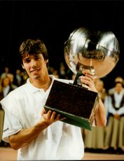 Tennis player Michael Stich with his cup after winning in the Stockholm Open