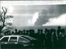People came to the area of the coast as catastrophe happens, from where they are could be seen the thick cloud of smoke from the oil fire carrying the Urquiola.  Taken - Circa 1976