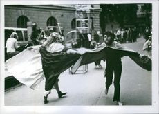 Man and woman performing in street.