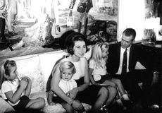 Juan Carlos I sitting with his wife Sofia and children.