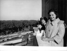 Rita Hayworth standing on balcony with her family.