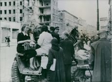 This peasant cart serves as a bus for Warsaw citizens, but there never enough seats for everybody. 1946