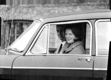 A couple on a joy ride. Smiling while watching the view from their automobile.