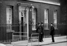 Policemen on duty off 10 Downing Street.