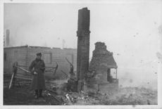 A man standing on house ruins.  Taken - Circa 1939