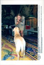 Princess Madeleine plays with her dog Jambo at Drottningholm Castle.