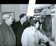 André Morell, Jon Phillips, Yvonne Bonnamy and Sheila Cooper in front of showcases