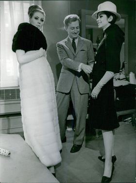 A lady fitting an new dress. February 28, 1964