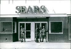 Soldiers standing outside.