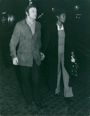 Dionne Warwick walking with Pietro Gilberto Tacchini while holding hands. Photo taken on February 14, 1972.