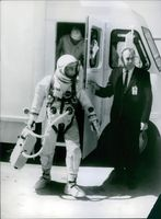 A astronaut going out of a car. March 22, 1965.