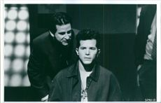 Anthony LaPaglia and John Leguizamo in a scene from the film Whispers in the Dark, 1992.